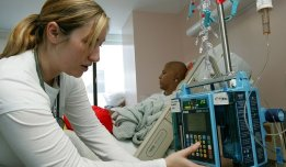 SAN FRANCISCO - AUGUST 18: Registered nurse Autumn Small adjusts an IV drip machine for eighteen-year-old cancer patient Patrick McGill as he receives treatment for a rare form of cancer at the UCSF Comprehensive Cancer Center Childrens Hospital August 18, 2005 in San Francisco, California. The UCSF Comprehensive Cancer Center continues to use the latest research and technology to battle cancer and was recently rated 16th best cancer center in the nation by US News and World Report. (Photo by Justin Sullivan/Getty Images)