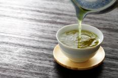 pouring-green-tea-into-a-cup
