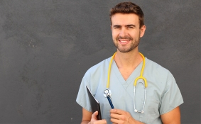 Sexy man in nurse suit with stethoscope