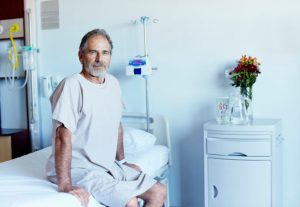 Mature man in hospital ward